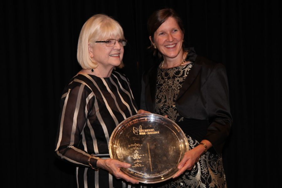 Judith Kennedy presents USA consul general Valerie Fowler with the trophy for the Wine of the Show.
